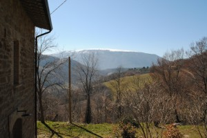 The view from the porch of  snow-topped Mount Subasio